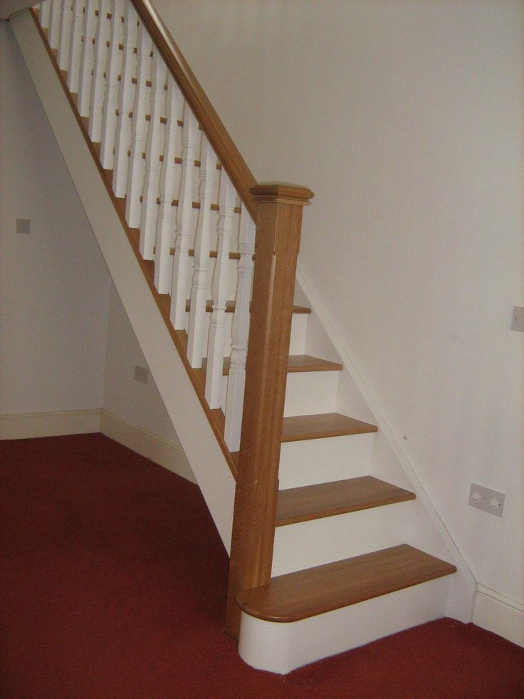 Oak and white staircase with white spindles and oak newelpost by Merrin Joinery #bespoke #stairs