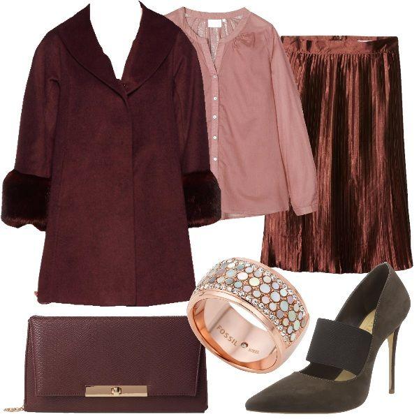 Sarebbe giusto farsi un regalo qualche volta. Un bell'anello può arricchire un bell'accostamento di abiti, rendendoti sempre più chic. Questo, ad esempio, in acciaio, costellato da strass è l'ideale. Indossiamo, invece, una gonna plissettata color rame, lucida, di grossa tendenza, una blusa rosa, da portare preferibilmente all'interno della gonna, il cappotto molto elegante, con ecopelliccia al collo e ai polsi, décolleté marroni, in nabuk e borsa a tracolla color burgundy.