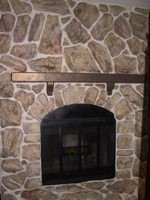 before and after rock fireplace makeover...rock white washed and dark grout painted light.
