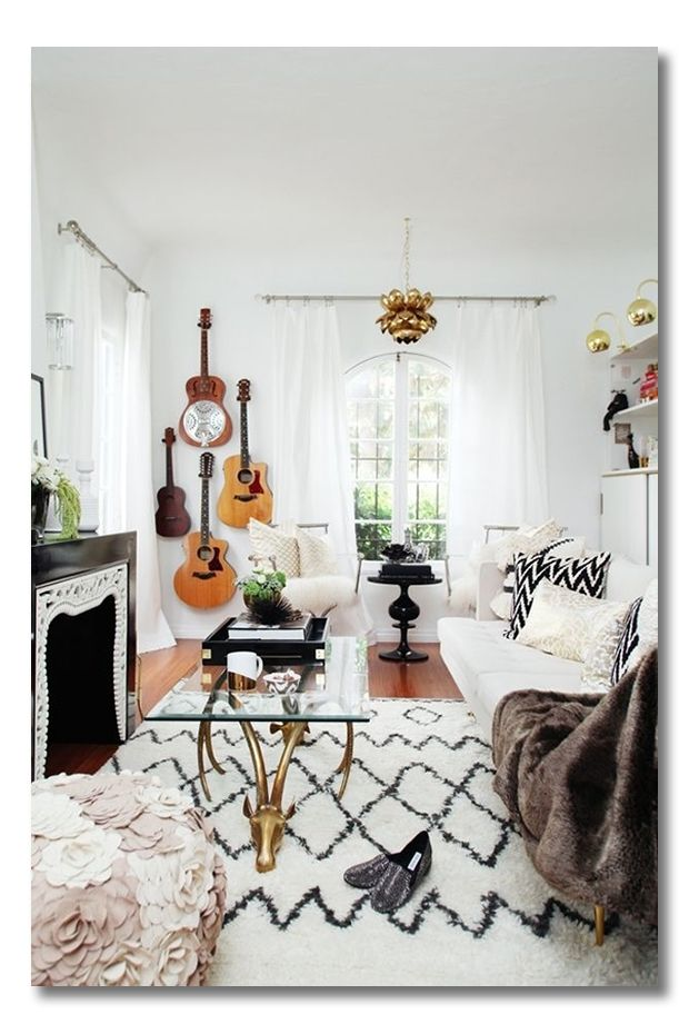 hang musical instruments on the wall - also, this lotus light fixture is amazing!!!