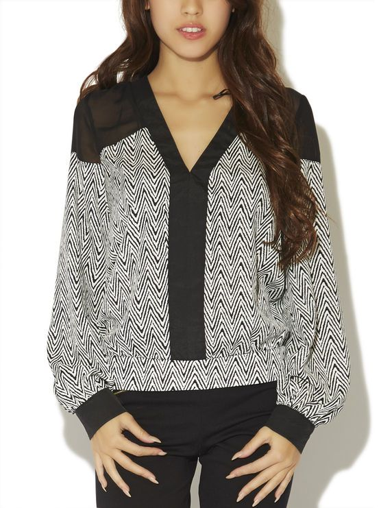 """This gorgeous long-sleeve chiffon blouse has a zigzag print with contrasting V neckline and vertical panels along the bodice front and at the cuffs. It also includes sheer mesh panels at the shoulder and upper back. Each cuff includes two textured metal buttons and the hemline has stretch along the back for a comfortably fitted look. Unlined.  Model is 5'9"""" and wears a size small.  Polyester  Imported Hand Wash"""