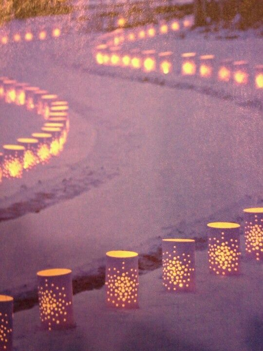 Paper bag lanterns lighting a pathway. There is no lighting to the parking area. This is an easy affordable option to guide the way.