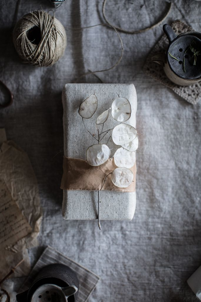 gift wrapping with silk and silver dollar plant