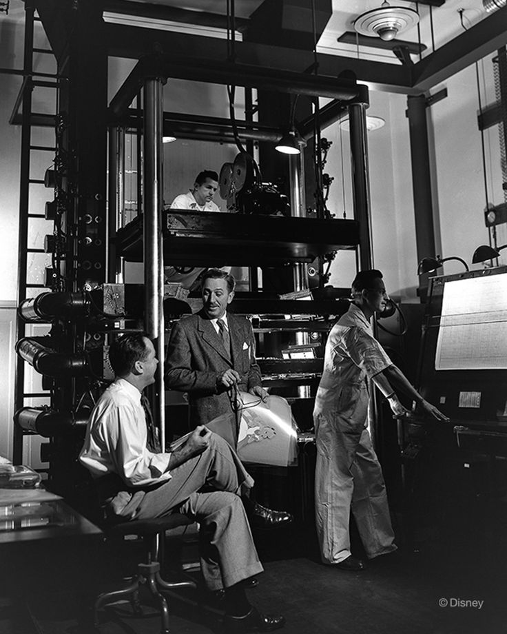 Walt Disney during production of Alice in Wonderland. The large camera stand being used is the multiplane camera - designed and built by the studio to add depth to animated cartoons.