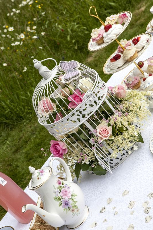 Summer Secret Garden tea party, vintage tea party wedding, vintage paper butterflies from Sweetpea and Ivy wedding decor