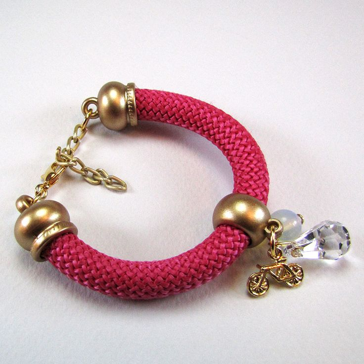 Bracelet with fuchsia climbing cord and golden matte endings, moonstone, golden bicycle element and transparent crystal.