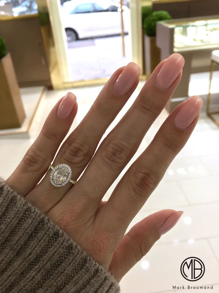 We couldn't be more thrilled about this two-toned oval engagement ring!