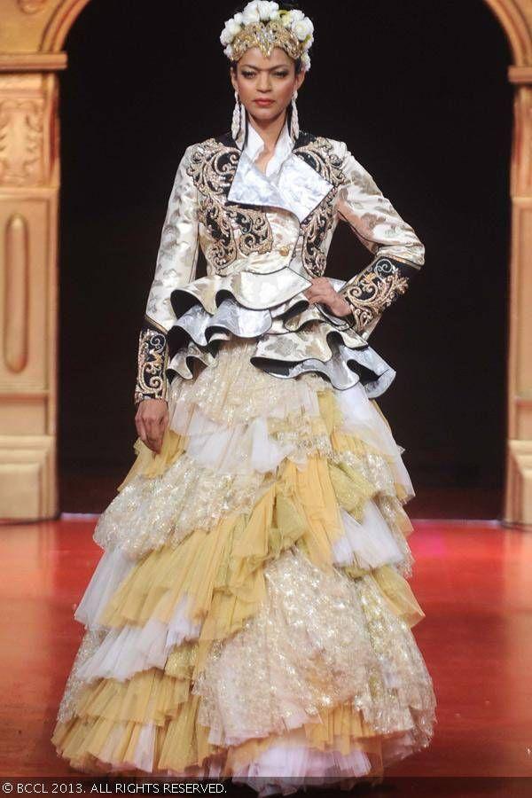 Noyonika Chatterjee walks the ramp during Ritu Beri's couture show, Spanish Fiesta, held at the residence of the Spanish ambassador to India, Gustavo De Aristegui, in New Delhi.