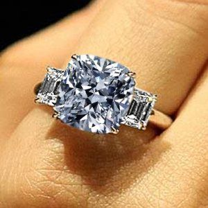 1.80 Total Carat Cushion, Round & Baguette Cut Diamond Three-Stone Engagement Ring in 18k Gold 1.00 Carat GIA Certified Center Diamond - Looking For Cushion Cut Engagement Rings? Here's Cushion Cut Diamond Information For You!