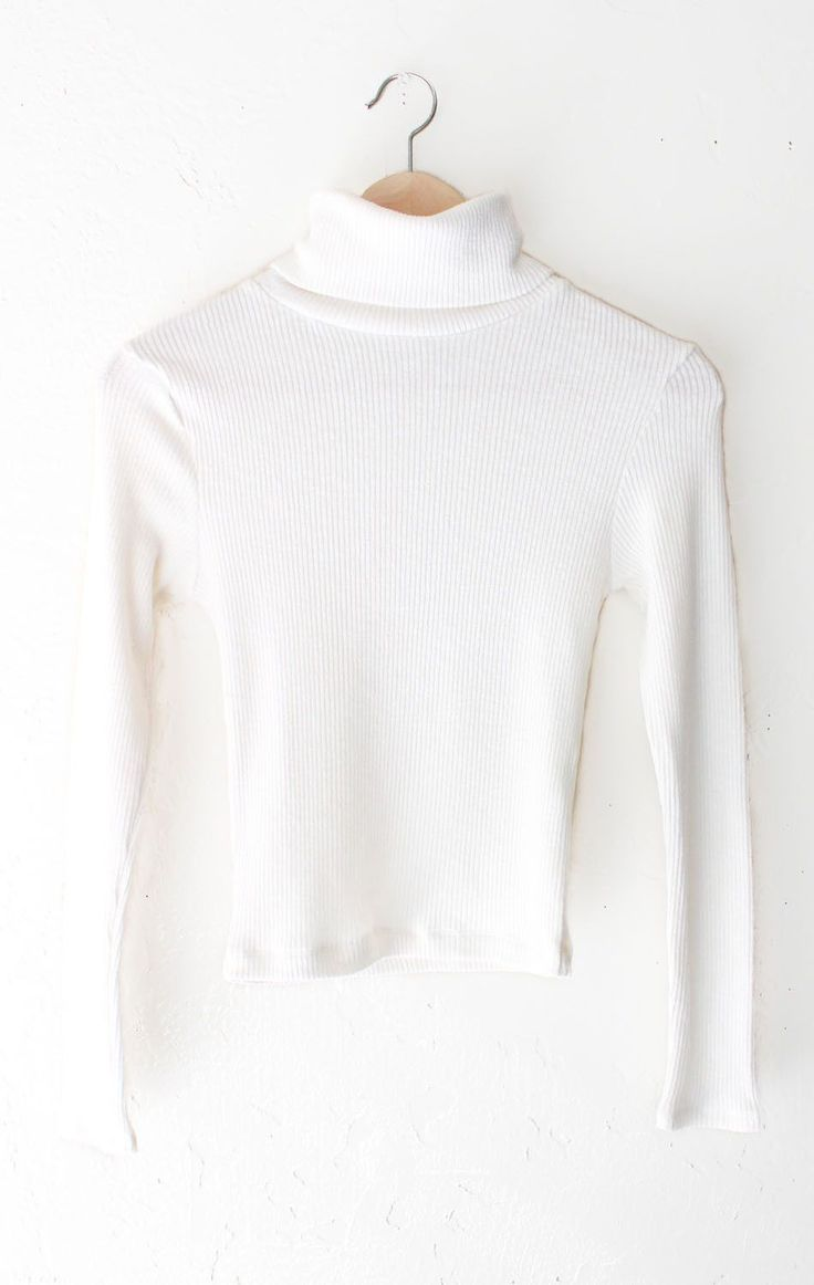 "- Description Details: Ribbed knit turtleneck long sleeve crop top in ivory. Form fitting, tend to run on the smaller side & are more fitted. Measurements: (Size Guide) S: 28"" bust, 18.5"" length, 21.0"
