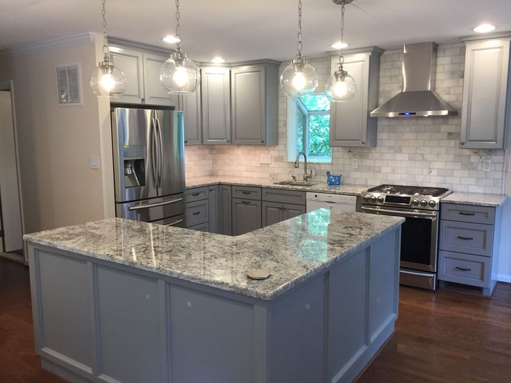 Bright Blue Grey Kitchen created with Baltic Bay Thomasville cabinets, White Ice granite, Greecian White Marble backsplash and stainless steel appliances.