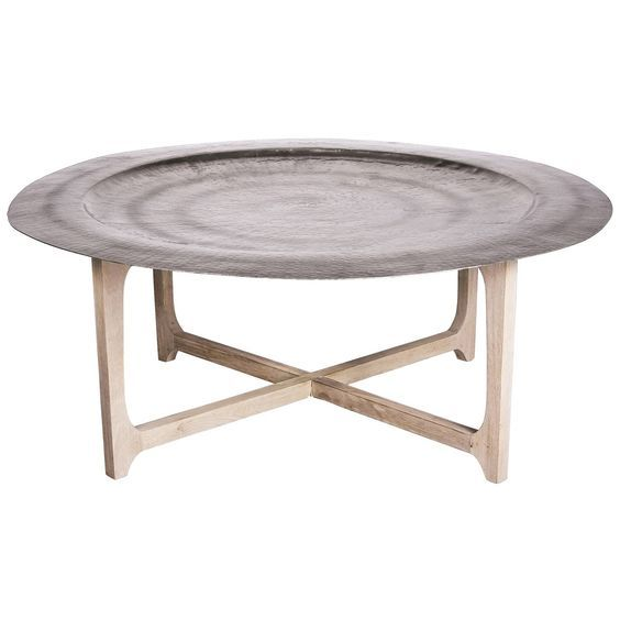 Evoke the allure of Morocco with the Laide Coffee Table. Featuring a simple natural wood cross leg base and hammered round tray top think contemporary Moroccan style with a neutral palette and cream and ivory bone inlay furniture.: