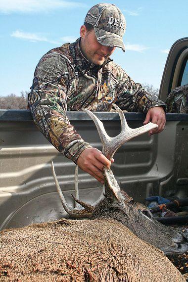 Jake Fagan with prime whitetail during Kansas hunt
