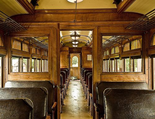 I get decorating ideas from vintage train interiors.  What a great room divider, and I LOVE the antique luggage racks!  They would be awesome in the bath, as towel racks... and in the bedroom for extra bedding, quilts, etc.