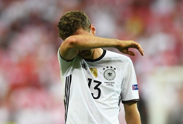 Thomas Mueller Photos Photos - Thomas Mueller of Germany reacts after his team's scoreless draw in the UEFA EURO 2016 Group C match between Germany and Poland at Stade de France on June 16, 2016 in Paris, France. - Germany v Poland - Group C: UEFA Euro 2016