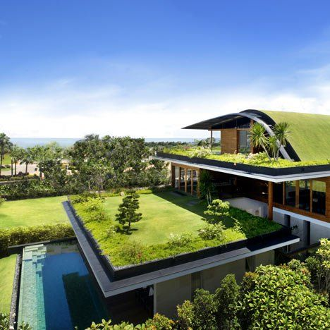 Here's a house with gardens on all three levels designed by Singaporean studio Guz Architects on Santosa Island, Singapore