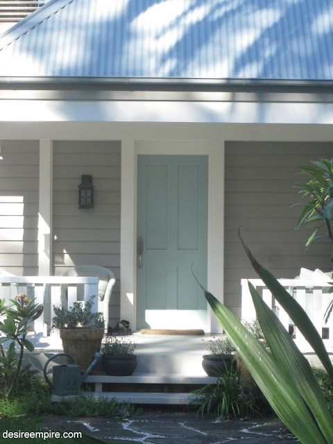 gray/white and turquoise light blue door