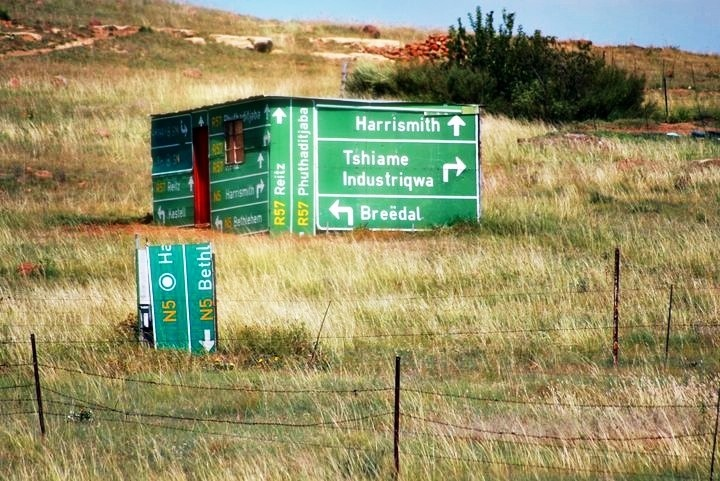 I love this picture on so many levels. Rural South Africa and this person used geographical motorist signs to construct the walls of his home. It reminds me of a South African saying 'Oos, wes, tuis bes' (East, west, home best)