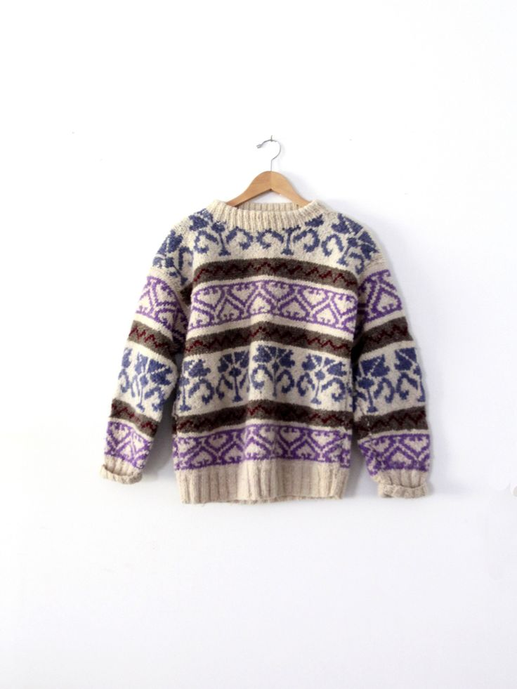 circa 1970s - 1980s Keep warm and cozy with this vintage chunky knit wool sweater. The hand knit pullover features a fair isle pattern in cream, purple, blue, and brown pattern. - thick knit wool swea