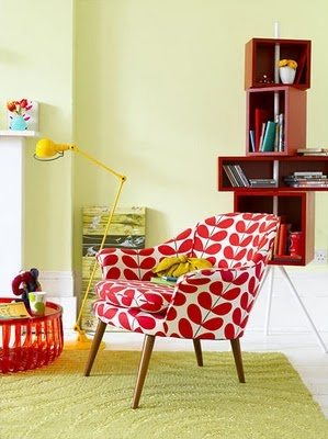 Love the red orla kiely fabric on that mid century modern chair and the bright yellow task lamp rocks!