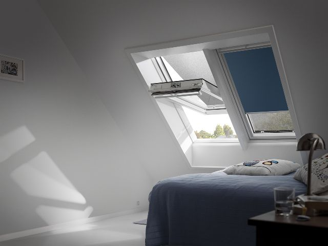 A #loftconversion #bedroom with blackout #VELUX #blinds that complement the décor and allow you to enjoy your weekend lie-ins.