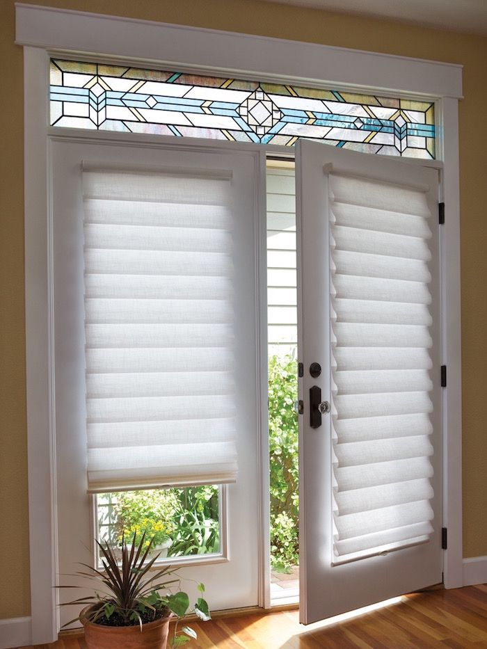 White Vignette Modern Roman Shades on a French Door, for sale at Classic Blinds & Shutters Design Center in Alpharetta