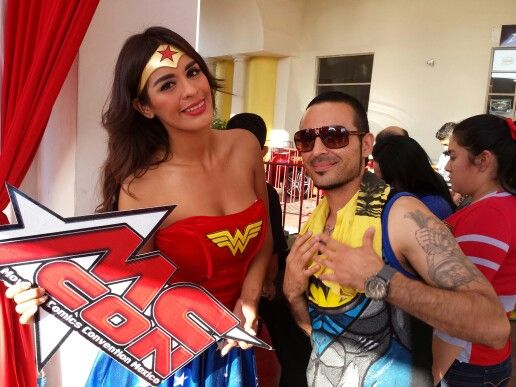 Taking a picture of wonderwoman with my homie chris