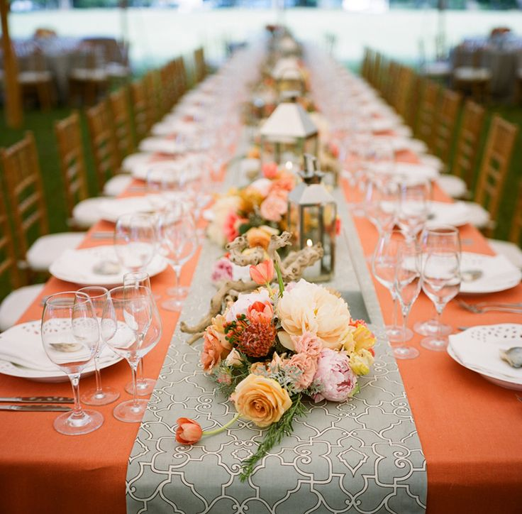 peach and grey tablescape. Low lying flowers allows guests to speak across the table.