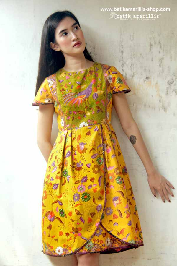 Batik Amarillis's blooming dress ...beautifully made dress to accompany you anytime or anywhere with Ties at back neck,back zipper closure , cap sleeve, side seam pockets, tulip skirt, fully lined in cotton with piping detail..you'll be falling hard in love with this !