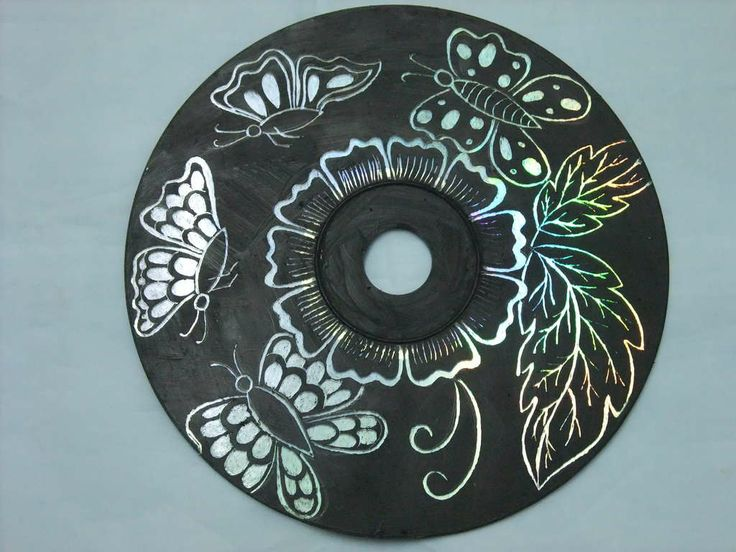 Paint CD with paint and then use sharp tool to scratch on your design.