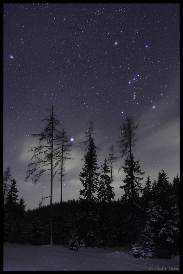 Constellation Orion, the Hunter, and Sirius, the brightest star of the night sky, shine over Fischbacher Alpen, near Alpine village of Krieglach in Austria. The three brightest stars in this view (Sirius, Rigel at Orion's foot, and Betelgeuse at Orion's shoulder) form a large, prominent asterism known as the Winter Triangle.