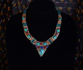 "This uniquly crafted necklace is Turkmen style purchased in Istanbul from our friends at Tribal Bazaar. It is made of turquoise, lapis, carnelian, coral, and silver beads with a silver pendant featuring embedded stone. It is 18"" and has a simple S hook and ring clasp."