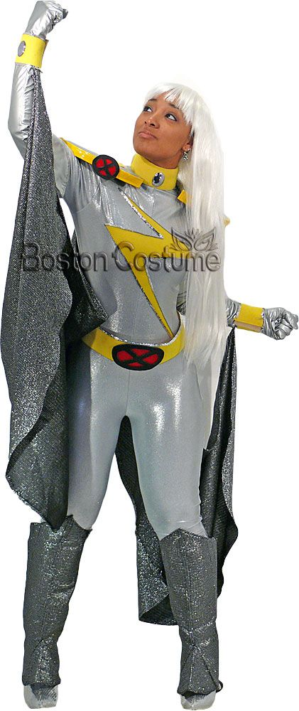 Rental includes: Jumpsuit - Stretchy silver jumpsuit that zips up in the back. There is a yellow lightning bolt with silver sequin trim across the chest. There is an attached yellow turtleneck collar with a silver disc on the front. Cape - Long silver and black metallic cape that attaches to the jumpsuit. The cape splits in the center of the back. Belt - Yellow belt with ...