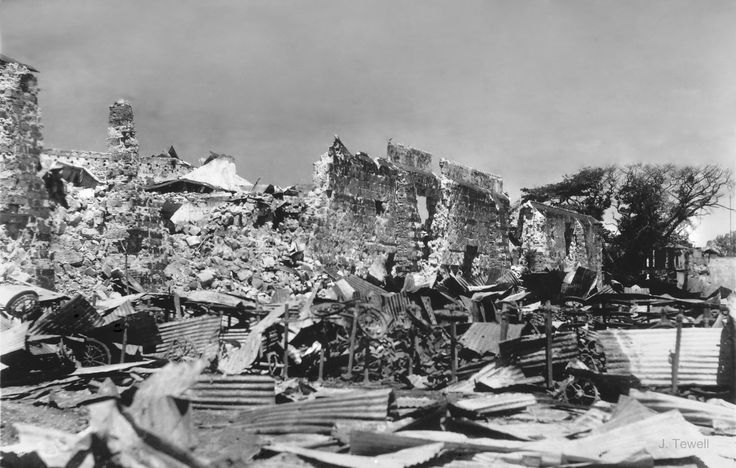 Ruined civilian houses after bombing runs in World War Two.