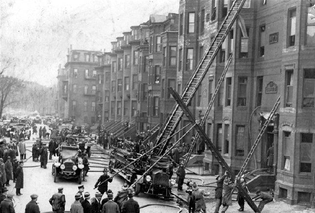 Companies raise a ground ladder at the scene of a 2-alarm fire on West Rutland Square, South End, 3-10-1925. Posted 12-3-2010.