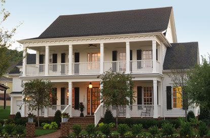Southern style home with wide covered verandas and balcony!! Yes please!