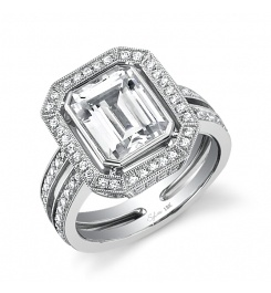 For When I Need To Upgrade :)  This is bold Platinum diamond engagement ring features a 3 carat emerald cut diamond. The center stone is surrounded by a halo of round brilliant diamonds that continue down the sides of this slit shank ring for a total carat weight of 1.05.