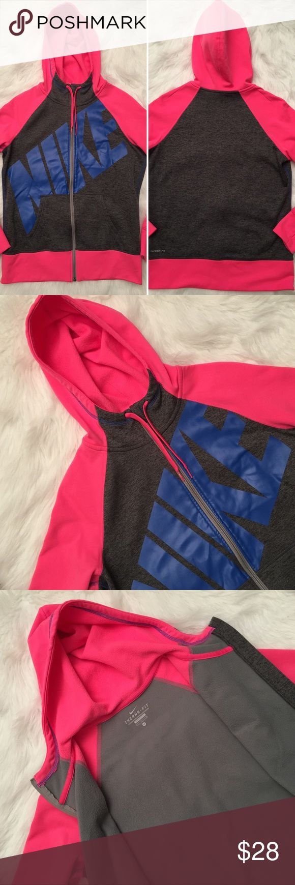 Nike Hoodie Therma Fit Zip Up Women's Medium EUC Nike Therma-Fit Zip Up Hoodie in a US Women's Medium. Colors are gray, blue, and pink. In excellent condition! Comes from a pet free/smoke free home :) Measurements taken laying flat:  Pit to pit: 21 inches Neck to bottom: 26 inches Sleeve length: 24 inches Nike Tops Sweatshirts & Hoodies
