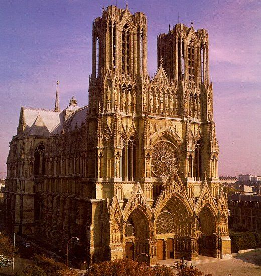 Reference for: First Library in Central. Front-facing facade, with the Catherine (rose) windows visible (corresponds to the Amplifici). Source: Reims Cathedral, Reims, France.