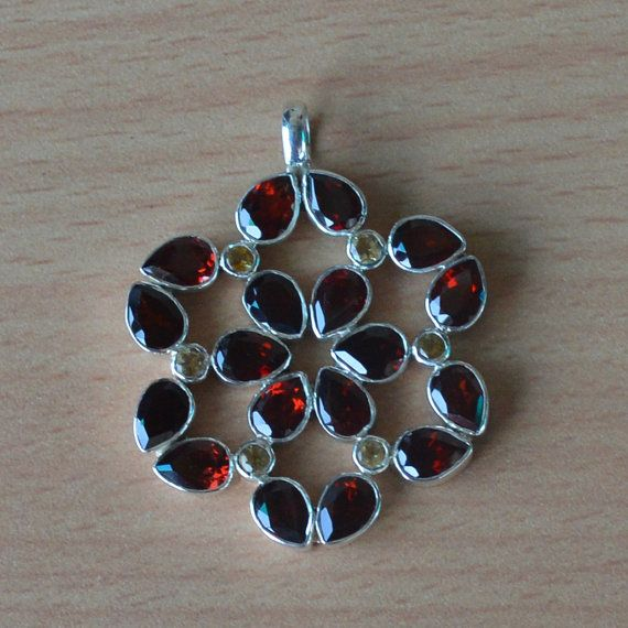 This week Summer/Father's Day offer:Get 25% discount on Min Purchase $25 coupon code - SUM15 for all products. Garnet & Citrine Gemstone Silver Pendant by DevmuktiJewels on Etsy