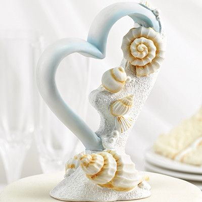 """Seaside Jewels Beach Themed Cake Topper This will look amazing on any cake, but especially for beach themed weddings. Realistic seashells and white sparkling sand cover one side of this light blue, heart-shaped resin cake top. 6"""" tall. #WeddingDresses #WeddingRings #WeddingGifts #Wedding #WeddingIdeas"""