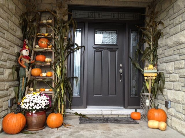 An old wooden ladder makes for a great fall decoration.: