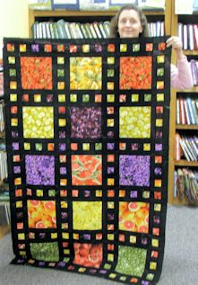 Beginner Quilt - I love all the small multi-color blocks surrounding the large focus block - really emphasizes it!