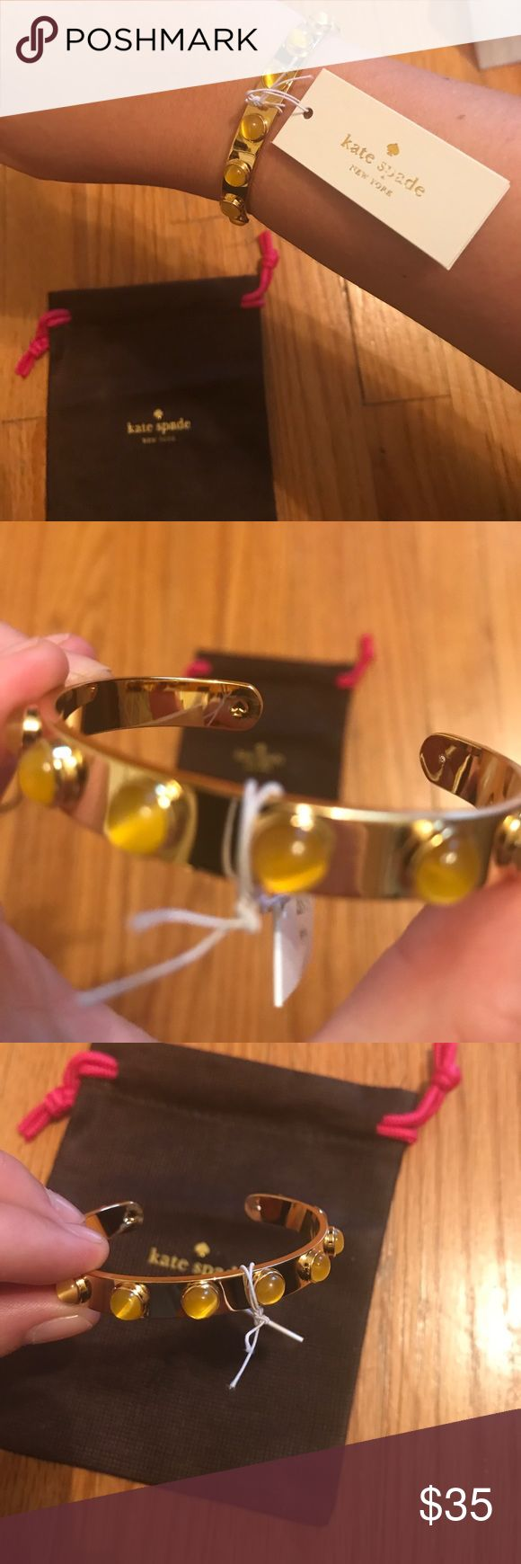 NEW//RARE Kate Spade yellow Tag Along cuff Brand new item.  Gold-plated thin cuff with yellow baubles.  RARE* the yellow color is sold out at Kate Spade and most retailers ♠️. Website: Pop in perfect color to complement your ensemble with the Kate Spade New York® Tag Along Cuff Bracelet. Gold-plated metal. Colorful yellow resin cabochons. Slip-on style.  Guaranteed AUTHENTIC.  Measurements: Width: 1⁄3 in Diameter/Length: 2 2⁄9 in Weight: 0.8 oz **purchase includes drawstring jewelry bag kate…