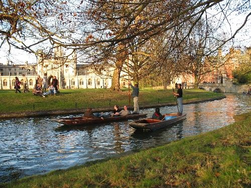 Punters on the River Cam in front of St. John's College at Cambridge University.