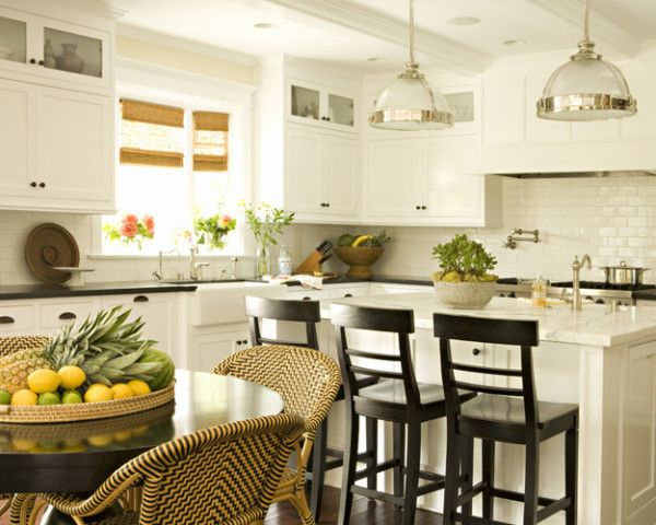 Marble island - neat, basic style of cabinets, and cool pendant lights over island