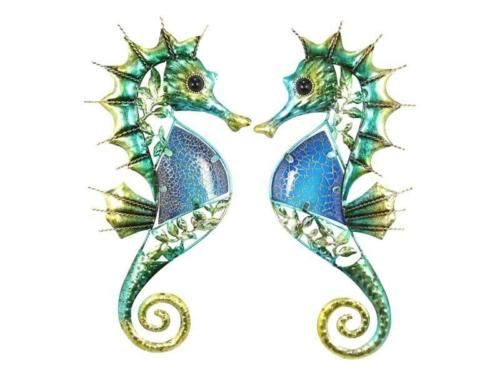 1-Pair-Seahorse-Sea-Horse-Ocean-Beach-Theme-Wall-Plaque-Hanging-Set-of-2 This stunning set of blue crackle seahorse plaques will brighten your walls with a fresh ocean / sea theme.  Beautifully detailed, this quality pair of seahorses are made from thin sheet metal and are finished with beautiful ocean blue & green hues. Measuring a genourus 38cm tall #seahorse #beach #ocean #wall #hanging