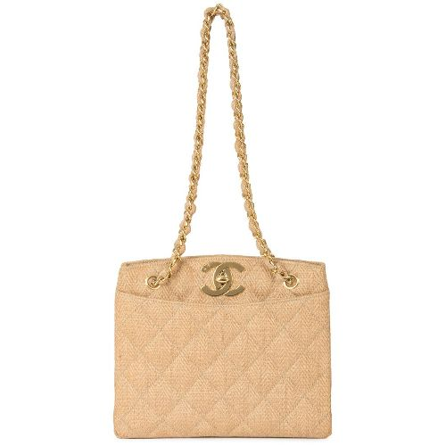Beige linen chain shoulder bag from Chanel Vintage featuring a woven effect, a quilted effect, a front slip pocket, a back slip pocket, a gold-tone chain shoulder strap, a gold-tone logo plaque, a gold-tone twist lock fastening, an internal zipped pocket and an internal logo stamp. Please note that vintage items are not new and therefore might have minor imperfections. Size: OS. Color: Brown. Gender: Female. Material: Linen/Flax/Leather.