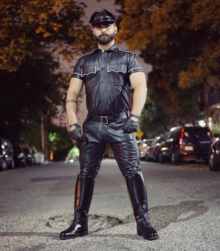Gay Men Dressed In Leather Dog Outfits Stock Photo