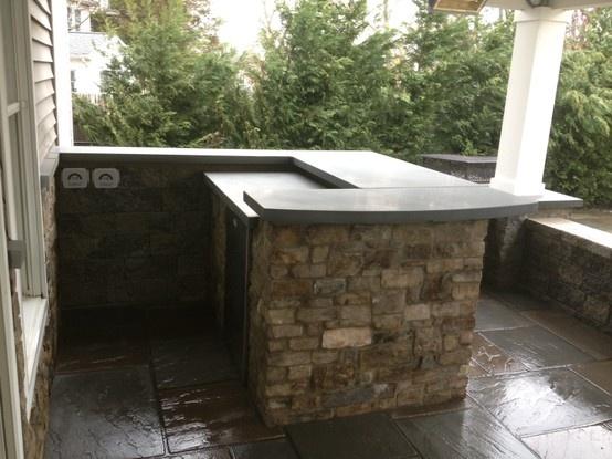 A Custom Natural Stone Service Bar With Polished Bluestone